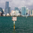 View of Miami Skyline with Manatee sign — Stok fotoğraf