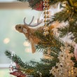 Cute raindeer on christmas tree detail - Stock Photo