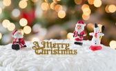 Icing on Christmas cake with tree lights — Stock Photo
