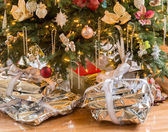 Silver presents under christmas tree — Stock Photo