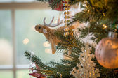 Cute raindeer on christmas tree detail — Stock Photo