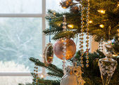 Decorations on christmas tree detail — Stock Photo