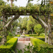 Old traditional garden with pathways and fountain — Stock Photo