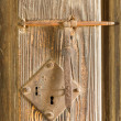 Antique rusty door lock on timber — Stockfoto