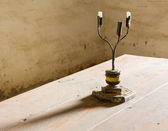 Old iron candlestick holder on table — Stock fotografie