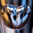 Macro close shot of heart in champagne glass — Stock Photo