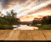 Old wooden table or walkway by lake — Foto Stock