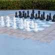 Full set of pieces outdoor chess in garden — Stock Photo
