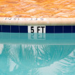 Five feet marking on swimming pool depth — Stock Photo