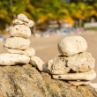 Stack of pebbles by ocean seaside — Stockfoto