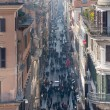 Shoppers crowd Via Condotti in Rome - Stock Photo