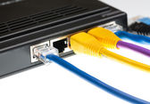 Cat5 cables and router for cyberdefence concept — Stock Photo
