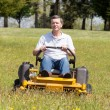 Senior man on zero turn lawn mower on turf — Stock Photo #22580081