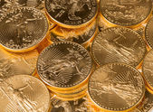 Collection of one ounce gold coins — Stockfoto