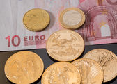 Gold coins on euro note bill with coins — Stock Photo