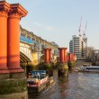 Underneath Blackfriars Bridge in London with boat — Stock Photo