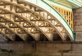 Underneath Southwark Bridge in London — 图库照片