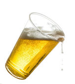 Golden lager or beer in disposable plastic cup — Stock Photo