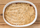 Traditional british apple crumble pie in dish — Stock Photo
