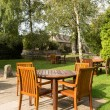 Garden and tables in Cotswold district of England — Stock Photo #33589605