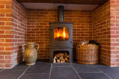 Wood burning stove in brick fireplace — Foto de Stock