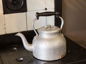 Old fashioned kettle on hob — Stock Photo