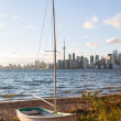 Sailing boat on Toronto Islands with city — Stock Photo