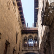 Narrow street and bridge Barcelona — Stock Photo