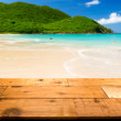 Warm sandy beach in caribbean by wooden decking — Stock Photo