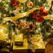 Stock Photo: Beautiful xmas tree with focus on details of gifts
