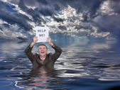 Senior man holding help me paperwork in water — Foto Stock