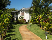 Pathway through landscaped ground at resort — Stock Photo