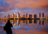 San Diego skyline at dusk reflected in sea — Stock Photo