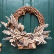 Traditional xmas wreath on front door — Stock Photo