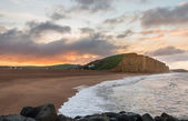 Sun rises at West Bay Dorset in UK — Stock Photo