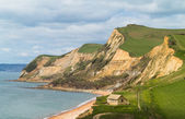 Cottage by cliffs at West Bay Dorset in UK — Stock Photo