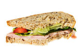 English multigrain bread ham sandwich with bite — Stock Photo