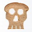 Slice of wholewheat bread in shape of skull — Stock Photo #49381105