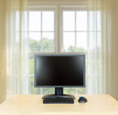 Plain office desk with monitor with window — Stock Photo