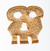 Slice of wholewheat bread in shape of skull — Stock fotografie