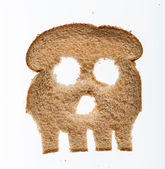 Slice of wholewheat bread in shape of skull — Stock Photo
