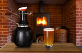 Growler and glass of beer at home — Stock Photo