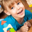 Child plays with toy blocks — Stock Photo #17471749