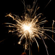 Yellow sparkler holiday — Stock Photo