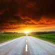 Asphalt road with cloudy sky — Stock Photo