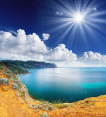 Sea and clouds sky with sun — Stok fotoğraf