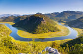 Sinuous river flowing through mountains. — Stock Photo