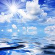 Sea with cloudy blue sky — Stock Photo