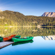 Mountain lake and boats — Foto Stock
