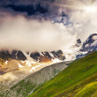 Alpine meadows with dramatic sky — Stock Photo #32165681